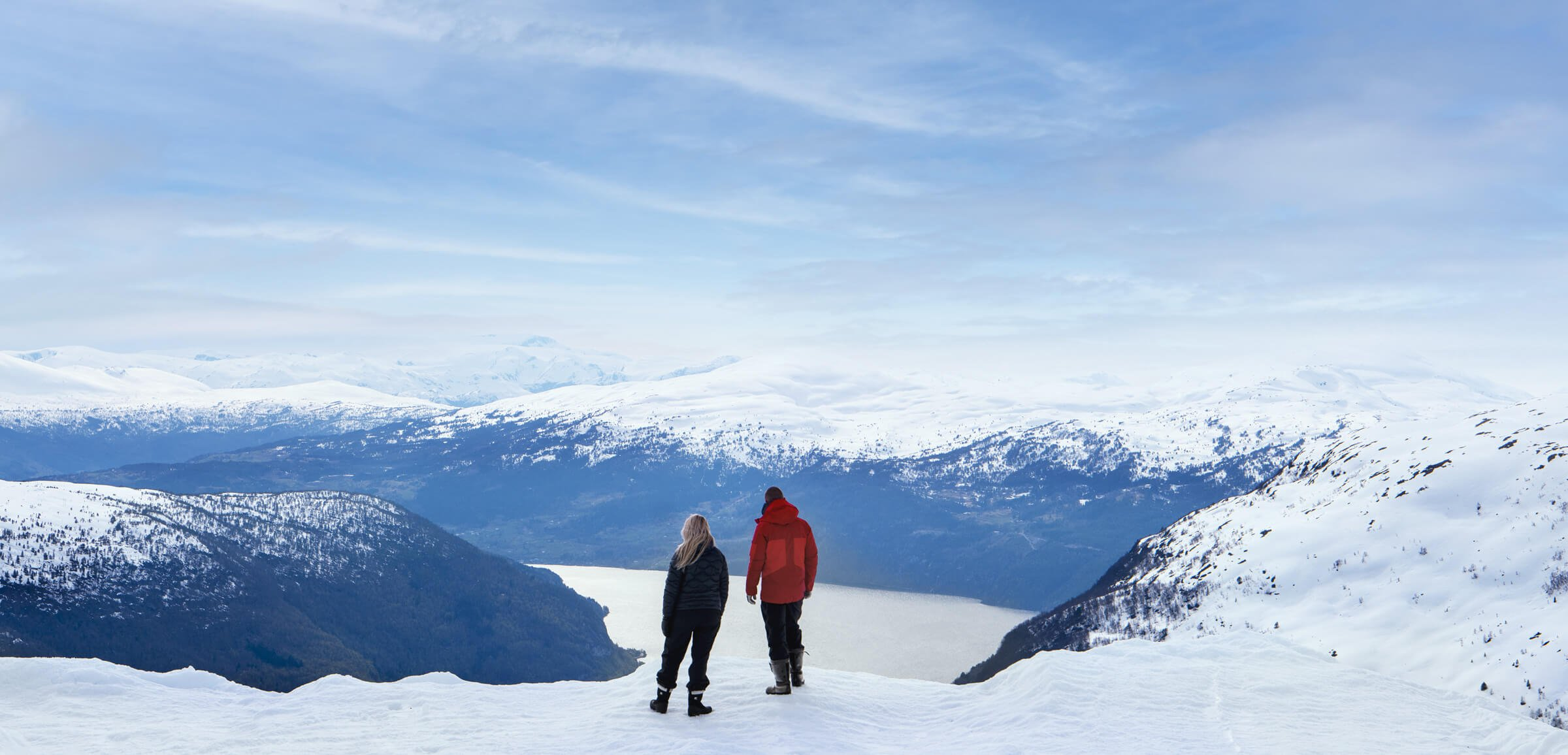 A couple looking at snowy mountains